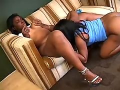 Two sexy black lesbians caress each other