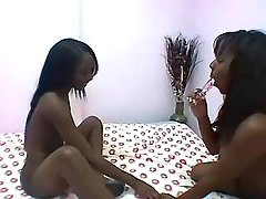 Two black lesbians enjoy oral sex by pool